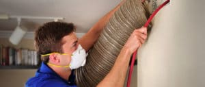 Technician cleaning air ducts