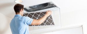 Air duct cleaning technician at work