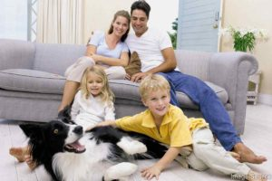 Family with a pet after air duct cleaning service