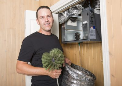 Air duct cleaning technician